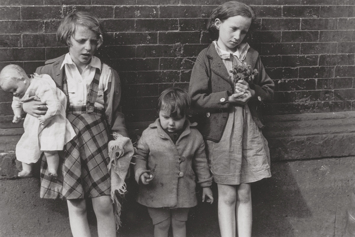 Helen Levitt - Three Children with Doll and Flowers