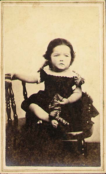 W. G. Smith - Frowning Little Girl Who Has Taken off Her Stockings