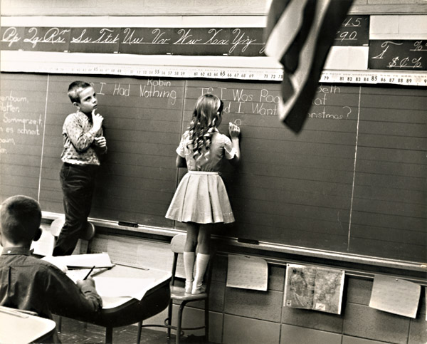 Rohn Anderson Engh - Children at Blackboard (American Flag in Foreground)