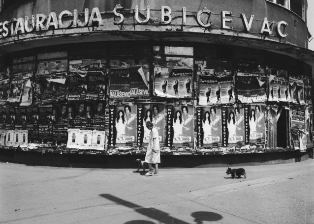 Stanko Abadžic - Old Woman and Dogs in Front of Posters